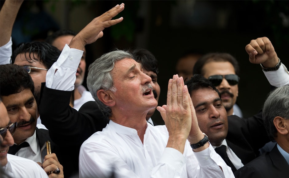 Senior opposition politician Jehangir Tareen celebrates the dismissal of Pakistani prime minister Nawaz Sharif outside the Supreme Court in Islamabad. The court also ordered the National Accountability Court to start a corruption case against Sharif, his children — Hussain and Hassan — and his daughter Maryam. AP