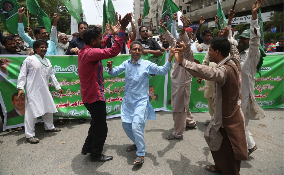 Supporters of the opposition parties celebrate the dismissal Nawaz Sharif's dismissal in Karachi. It is the third time the 67-year-old veteran politician's term as premier has been cut short. It was later announced that Shehbaz Sharif, Nawaz's brother would replace him as the next prime minister of Pakistan. AP
