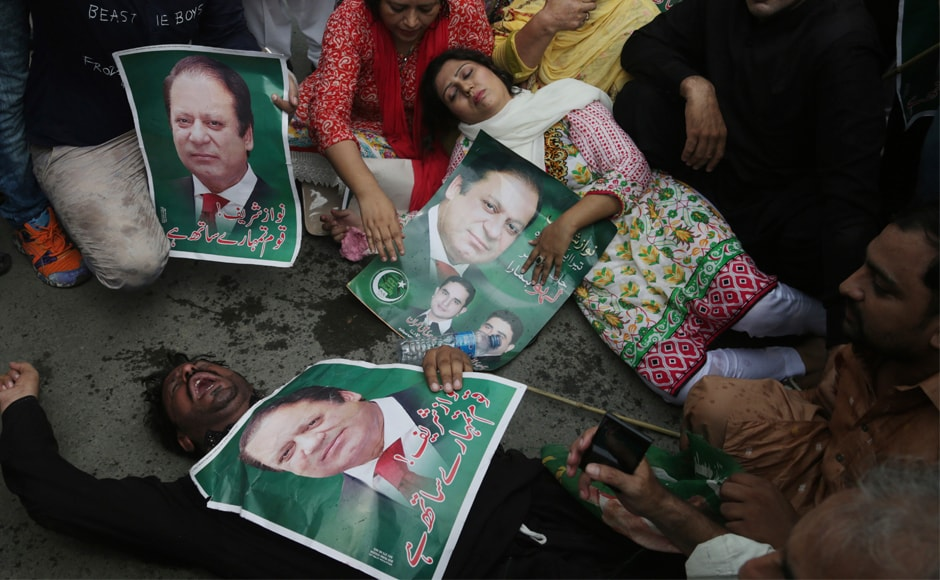 Supporters of PML-N gesture during a rally to condemn the dismissal of their leader in Lahore, Pakistan, AP