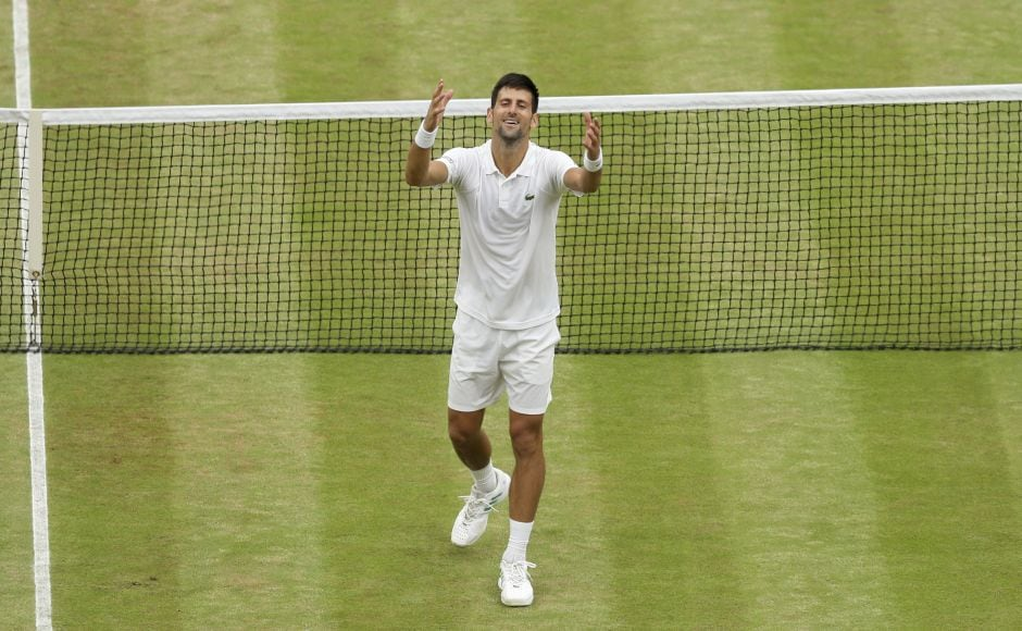 Novak Djokovic celebrates beating Adrian Mannarino in their fourth round match. Djokovic eased into the quarter-finals a day later than expected with a 6-2, 7-6(5), 6-4 win.