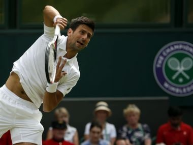 Serbia's Novak Djokovic serves to Slovakia's Martin Klizan during their Men's Singles Match on day two at the Wimbledon Tennis Championships in London Tuesday, July 4, 2017. (AP Photo/Alastair Grant)