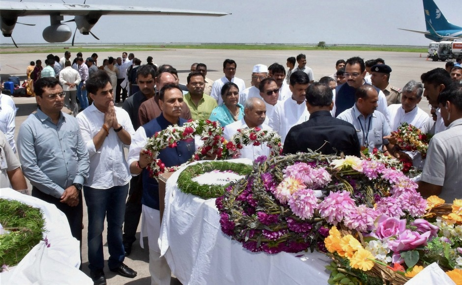 Gujarat chief minister Vijay Rupani received the bodies of seven Amarnath pilgrims at Surat airport killed in a terror attack  in Jammu and Kashmir on Monday. An alert was issued in Gujarat as five of those killed were from the state. PTI