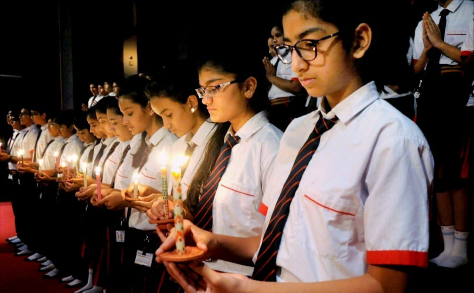 In Surat, school students paid tribute by praying and lighting candles for the victims. PTI