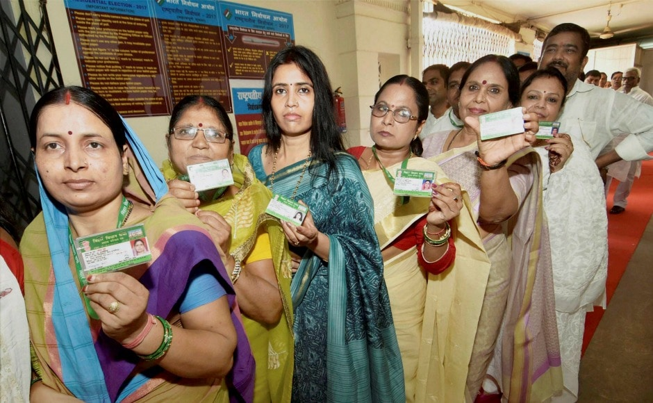 Legislators in Bihar show their identity cards as they queue up outside the Vidhan Sabha to cast their votes for presidential election. The total value of the electoral college is 10,98,903. PTI