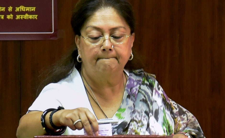 Rajasthan chief minister Vasundhara Raje is seen casting her vote at Rajasthan Assembly in Jaipur. In the presidential elected members of both houses of Parliament and Assemblies in states, are eligible to vote. PTI
