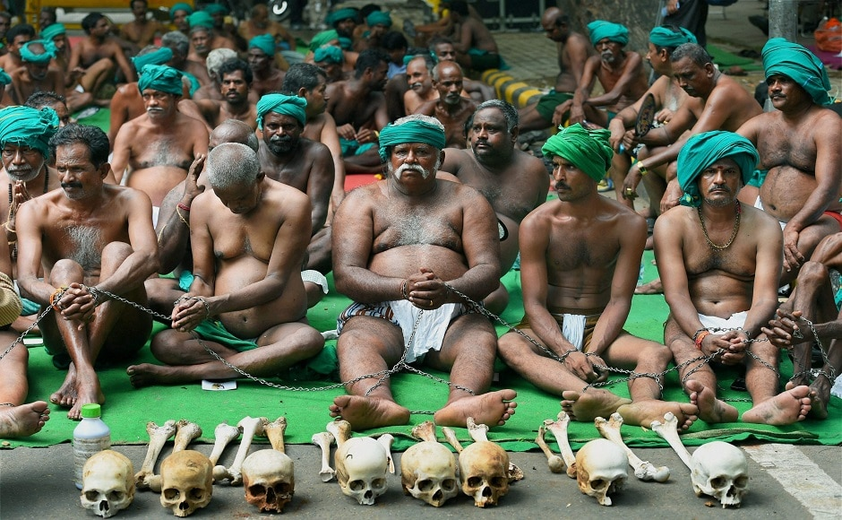 Scores of Tamil Nadu farmers, who had grabbed eyeballs with their unique protest earlier in the year, landed at New Delhi to resume their agitation for loan waiver and drought-relief package on Sunday. PTI