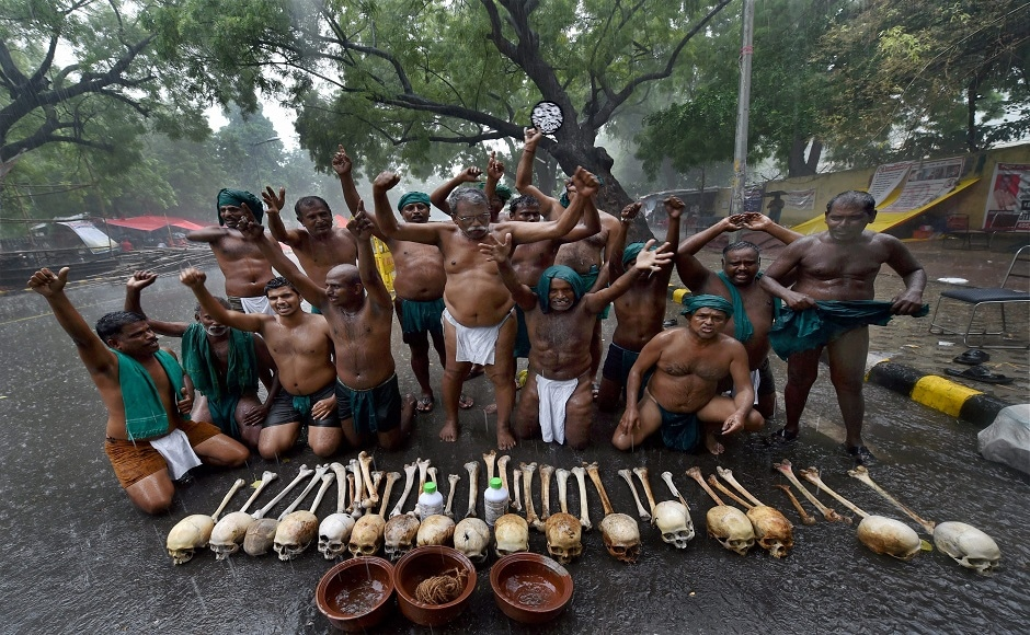 """The farmers, clad in green loin cloth, demonstrated with the skulls of their peers and two bottles of poison. P Ayyakkannu, the leader of the group of farmers said that, """"Rain or sun, our agitation will not stop,"""" PTI"""