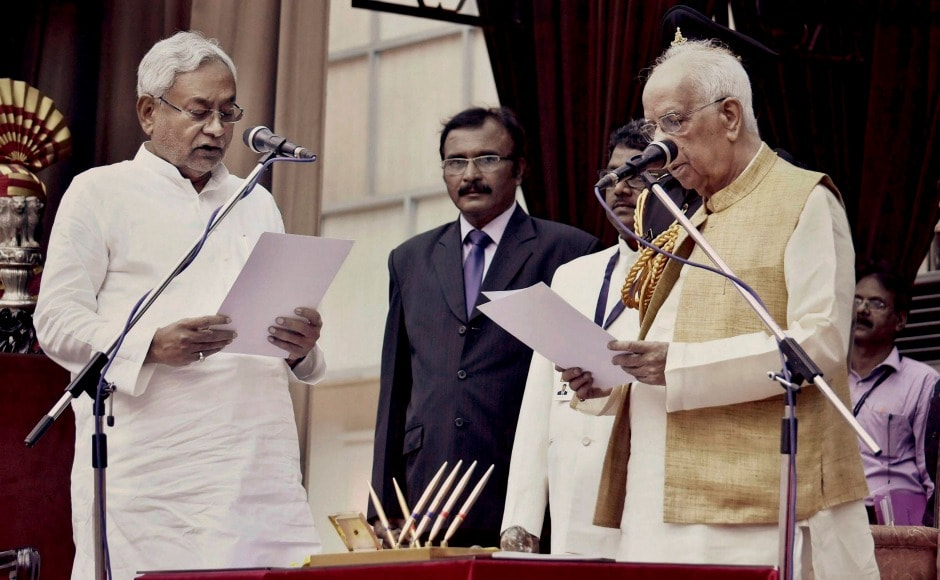 Bihar governor Keshari Nath Tripathi administers oath to JD(United) president Nitish Kumar as Chief Minister of Bihar at Raj Bhawan. Nitish Kumar returned as the Bihar chief minister for the sixth time. The development occurred barely a day after his dramatic resignation on Wednesday. Kumar's political manoeuvre dented the Opposition's unity, which could have a bearing on the 2019 Lok Sabha polls. PTI