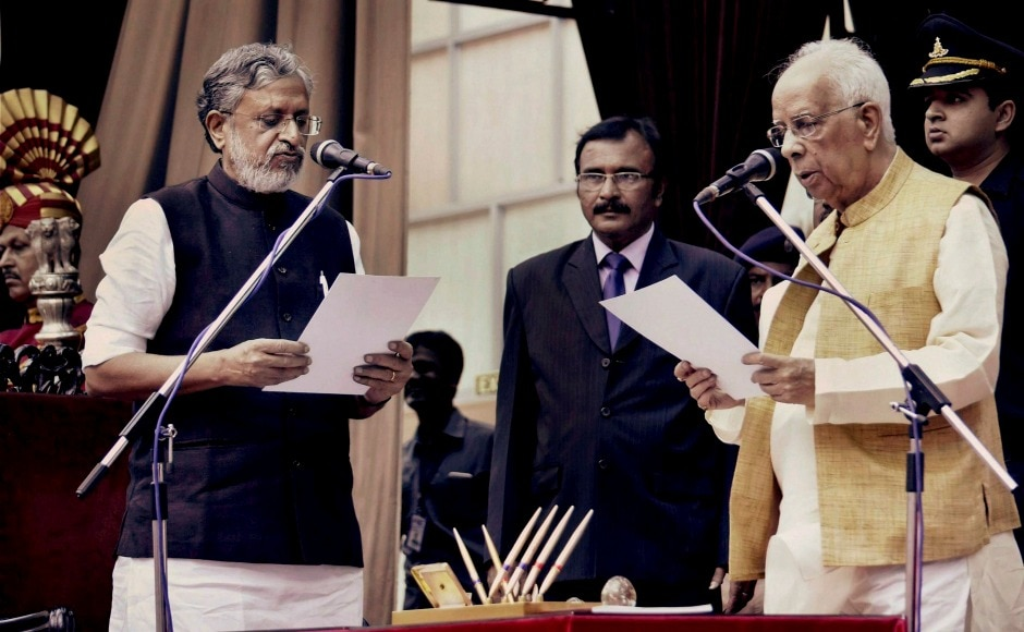 """BJP leader Sushil Kumar Modi taking oath at Raj Bhawan. Nitish Kumar broke the grand alliance with the RJD and formed a government with the BJP. """"I took the decision to form the new government in the interest of Bihar ... I am committed to the development of Bihar,"""" Kumar said about the decision. However, RJD leader Lalu Prasad Yadav dubbed Nitish as an """"opportunist."""" PTI"""