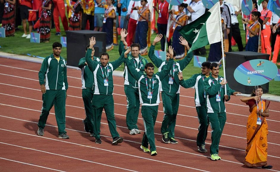 Pakistani athletes march past during the opening ceremony. PTI