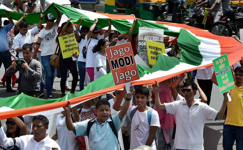 The protesters, on Sunday, marched from Rajghat to Jantar Mantar carrying a 110-metre long national flag depicting 110 years of their struggle for a separate state. PTI