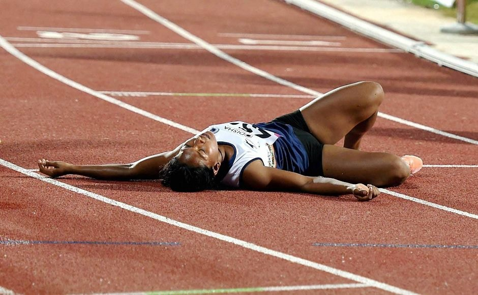 India's Swapna Burman collapses after winning the gold in the women's Heptathlon. PTI