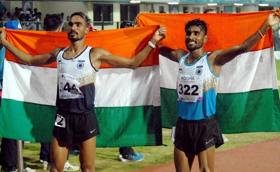 G Lakshmanan (R) and Gopi Thonakal after winning Gold and Silver respectively in Men's 10,000 mtr event. PTI