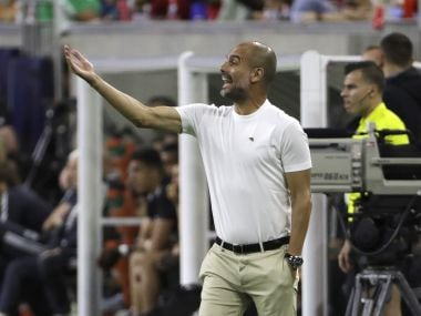 Manchester City coach Pep Guardiola directs his team during the International Champions Cup. AP