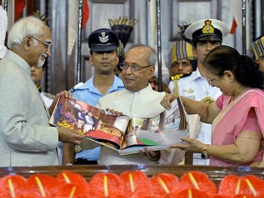 President Pranab Mukherjee presented a coffee-table book by Vice-President Hamid Ansari and Lok Sabha Speaker Sumitra Mahajan during his farewell ceremony in the Central Hall of Parliament in New Delhi on Sunday. PTI