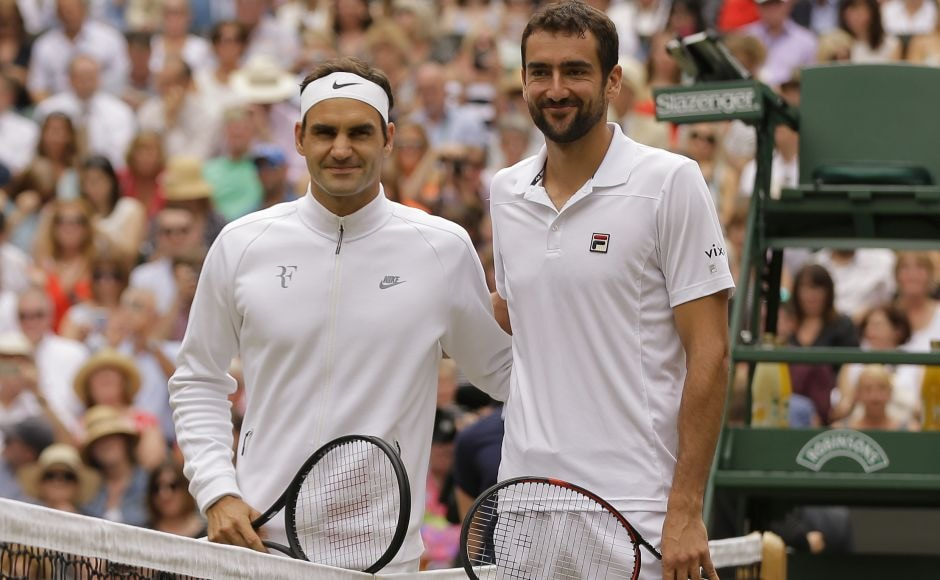 Roger Federer and Marin Cilic pose for a photo at the net before the Wimbledon final. Federer won the toss and elected to receive. AP