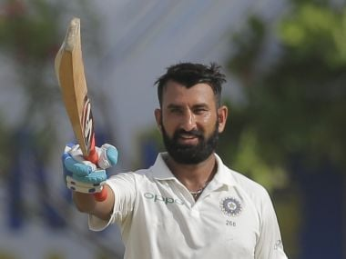 India's Cheteshwar Pujara celebrates scoring a century during the first day's play of the first test cricket match between India and Sri Lanka in Galle, Sri Lanka, Wednesday, July 26, 2017. (AP Photo/Eranga Jayawardena)