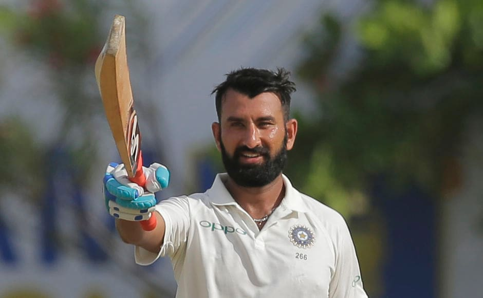Cheteshwar Pujara's purple patch continued. He slammed his 12th Test ton and remained unbeaten on 144. AP