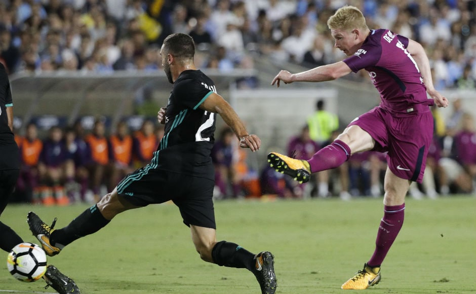 Manchester City's Kevin De Bruyne, right, shoots under pressure from Real Madrid's Daniel Carvajal during the first half. AP