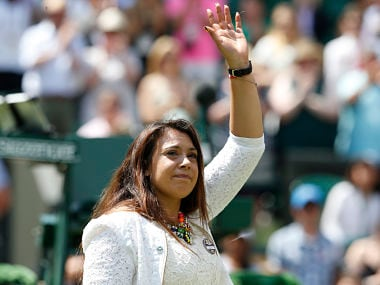 The 2013 women's singles champion, Marion Bartoli, who has retired from competition, waves during event on Centre Court to honour British player Elena Baltacha who died earlier this, year at the Wimbledon Tennis Championships, in London June 24, 2014. REUTERS/Suzanne Plunkett (BRITAIN - Tags: SPORT TENNIS) - RTR3VG8Z