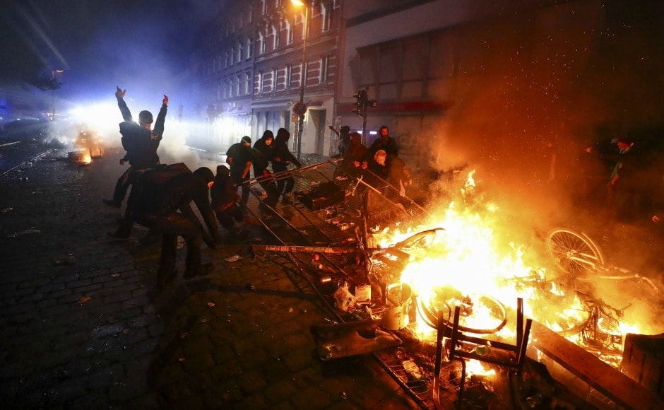As world leaders started to arrive in Hamburg, protesters set dozens of cars and barricades on fire blocking the way of delegations . Reuters