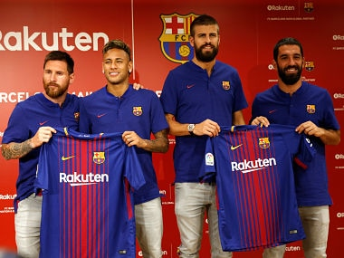 FC Barcelona players (L-R) Lionel Messi , Neymar, Gerard Pique and Arda Turan holding their uniforms pose for a photo during a news conference to announce the sponsorship deal between the team and Japanese e-commerce operator Rakuten Inc. in Tokyo, Japan July 13, 2017. REUTERS/Kim Kyung-Hoon - RTX3B8F6