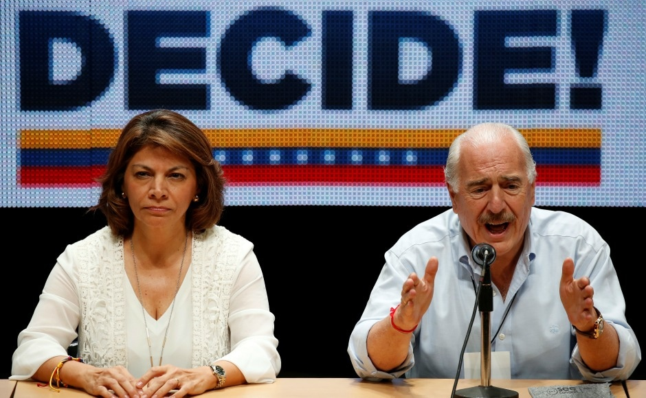 Former Colombian president Andres Pastrana (R) addresses the audience next to former Costa Rican president Laura Chinchilla.The event appeared to rejuvenate the Opposition amid weariness with street protests, but it is unlikely to lead to a change of government in the short term. Reuters