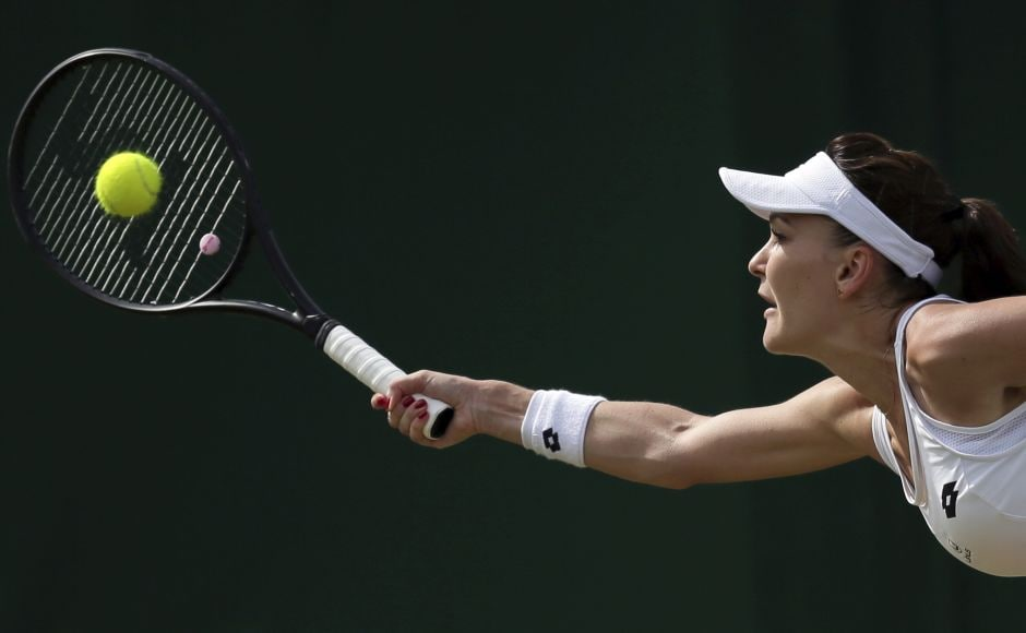 Agnieszka Radwanska fought her way through a tough opening set against Jelena Jankovic but wrapped up her match in two sets to move into the second round. AP