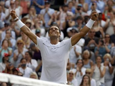 Spain's Rafael Nadal celebrates after winning against Russia's Karen Khachanov in their Men's Singles Match on day five at the Wimbledon Tennis Championships in London Friday, July 7, 2017. (AP Photo/Alastair Grant)