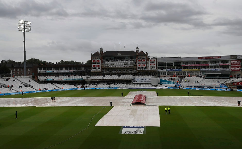 Rain covers on the pitch as rain stopped play on the third day of the third test match between England and South Africa at The Oval cricket ground in London, Saturday, July 29, 2017. (AP Photo/Kirsty Wigglesworth)