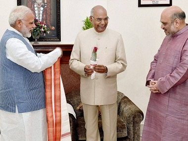 New Delhi: Prime Minister Narendra Modi and BJP President Amit Shah greet Ram Nath Kovind on being elected as the 14th President of India, in New Delhi on Thursday. PTI Photo by Manvender Vashist (PTI7_20_2017_000204B)