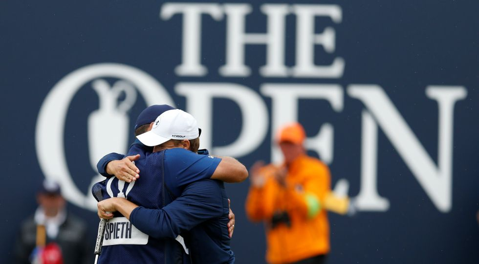 Jordan Spieth celebrates with his caddie after holing a putt on the 18th green to win The Open Championship. Reuters
