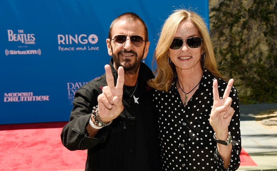 Starr and his wife Barbara Bach give the peace sign to photographers. Photo by AP