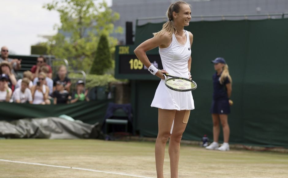 Slovakia's Magdalena Rybarikova smiles after beating Ukraine's Lesia Tsurenko. AP