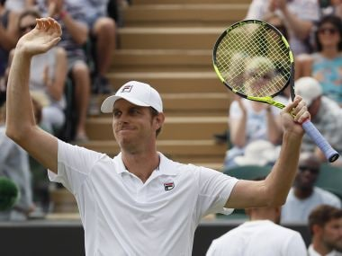 Sam Querrey of the United States celebrates after beating Jo—Wilfried Tsonga of France in the Men's Singles Match on day six at the Wimbledon Tennis Championships in London Saturday, July 8, 2017. (AP Photo/Kirsty Wigglesworth)