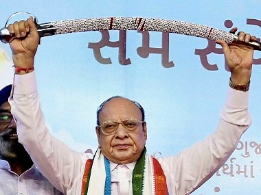 three party MLAs considered close to Shankarsinh Vaghela quit and joined the BJP. PTI