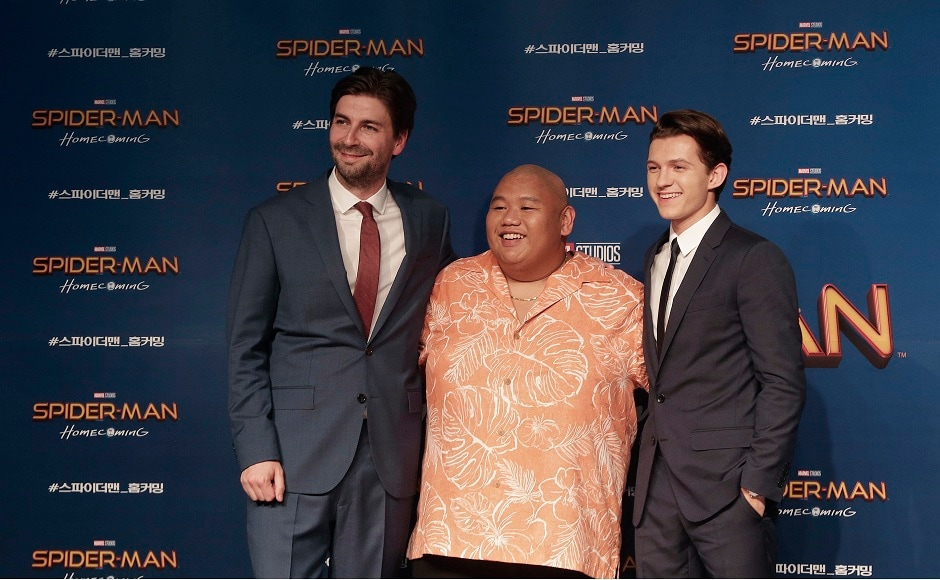 Director Jon Watts, left, and actors Jacob Batalon, center, and Tom Holland, pose during a promotional event for their latest film Spider-Man: Homecoming in Seoul, South Korea, Sunday, 2 July, 2017. The film will be released in South Korea on 5 July. (AP Photo/Ahn Young-joon)