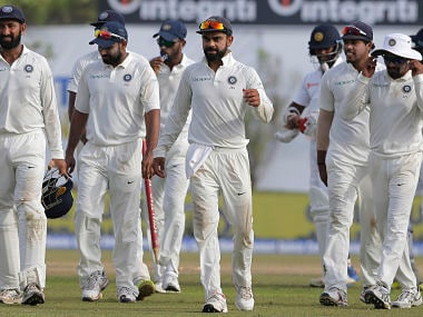 India's captain Virat Kohli leaves the ground with his teammates after their win in the first Test match against Sri Lanka. AP