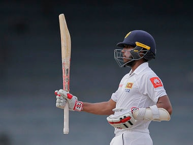 Sri Lanka's Kusal Mendis raises his bat after scoring fifty runs during the fourth day of the only Test match against Zimbabwe. AP