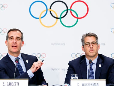 Eric Garcetti Mayor of Los Angeles, left, and Casey Wasserman chairman of Los Angeles 2024, right, answer questions during a press conference after the presentation of Los Angeles 2024 Candidate City Briefing for International Olympic Committee (IOC) Members, at the SwissTech Convention Centre, in Lausanne, Switzerland, Tuesday, July 11, 2017. (Valentin Flauraud/Keystone via AP)