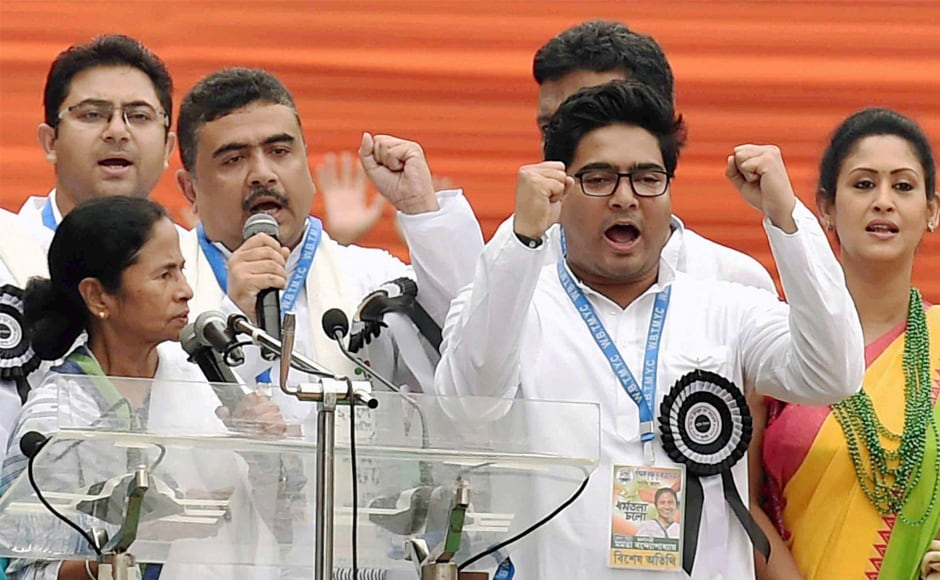 "TMC supremo and Banerjee with her nephew Abhisekh Bandopadhyay (right) and other party leaders while addressing the Martyrs' rally in Kolkata. Describing the prevailing situation in the country as worse than during the Emergency, she said opposition parties and a section of the media were being targeted for ""speaking against"" the Modi government. PTI"