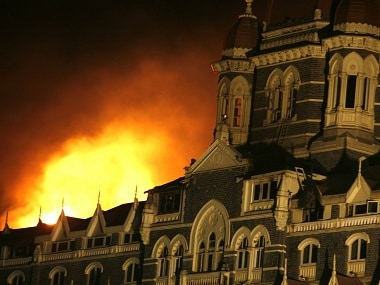 File image of smoke and fire billowing of the Taj Hotel in Mumbai November 27, 2008. Reuters