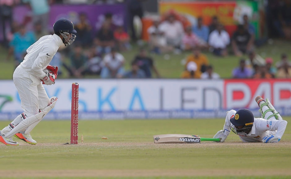 But Abhinav Mukund, at short leg, and wicketkeeper Wriddhiman Saha combined to send Upul Tharanga back to the hut. AP