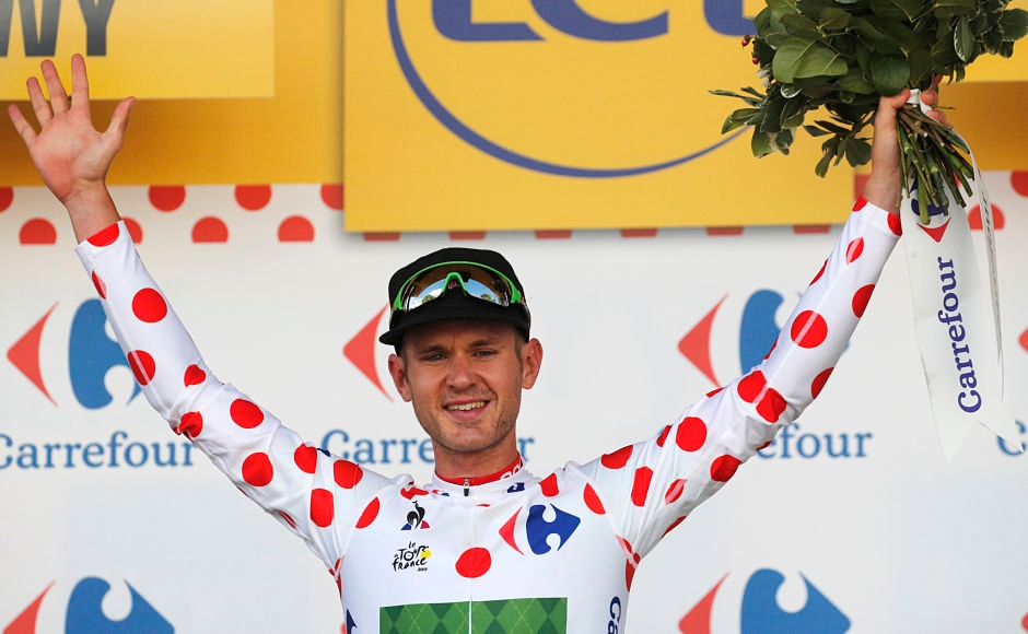 Nathan Brown of the U.S., wearing the best climber's jersey, celebrates on the podium after the third stage of the Tour de France cycling race over 212.5 kilometers (132 miles) with start in Verviers, Belgium and finish in Longwy, France. AP