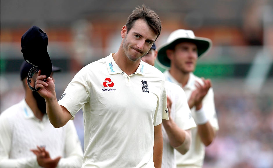 England's Toby Roland-Jones holds up his hat to applause as he leaves the pitch after taking the wicket of South Africa's Temba Bavuma on the third day of the third test match between England and South Africa at The Oval cricket ground in London, Saturday, July 29, 2017. (AP Photo/Kirsty Wigglesworth)