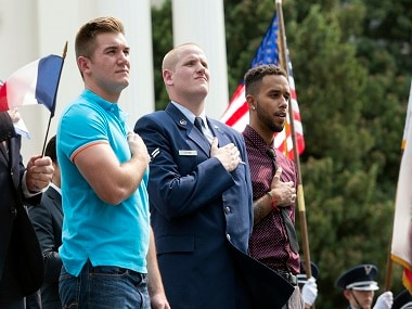 Oregon National Guardsman Alek Skarlatos, left, U.S. Airman Spencer Stone, center, and Anthony Sadler attend a parade held to honor the three Americans who stopped a gunman on a Paris-bound passenger train, in Sacramento, Calif. Image via AP