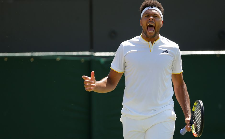 France's Jo-Wilfried Tsonga, the 12th seed, made short work of Italian qualifier Simone Bolelli in the sizzling heat, winning in straight sets. Reuters