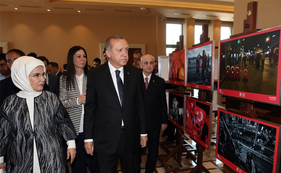 Erdogan, accompanied by his wife Emine, visits a photo exhibition prior to a ceremony to mark the anniversary of the failed coup attempt, in Ankara, on Thursday. Turkey has repeatedly pressed the United States to extradite Gulen, so far without success. AP