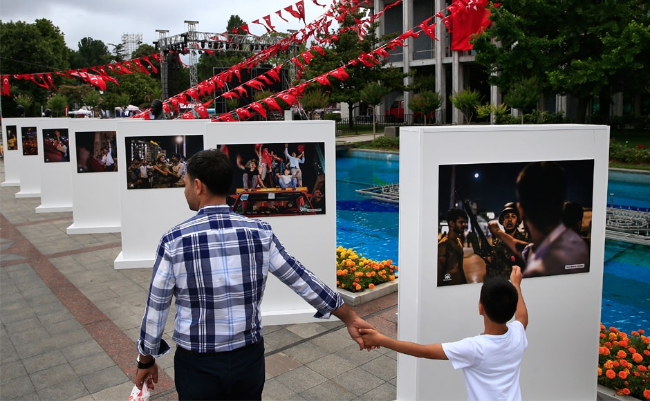 People visit an outdoor photo exhibition in Istanbul, featuring photographs of the takeover attempt. The attempt was the greatest challenge to the rule of Erdogan, who has been in power since 2003, first as prime minister and later as president. AP