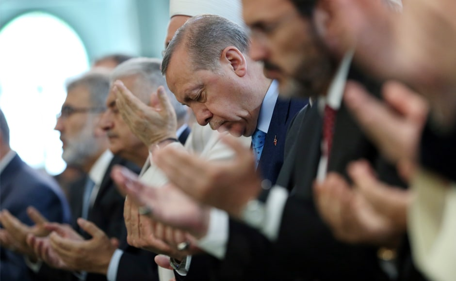 Turkey's president Recep Tayyip Erdogan, attends prayers for the victims of the 2016 failed coup attempt, at the mosque of the Presidential Palace in Ankara on Friday. AP
